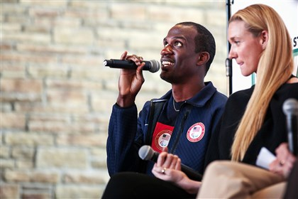 U.S. Paralympian Lex Gillette speaks to a panel about his training as a blind athlete at Dick's Sporting Goods' headquarters in Findlay. At his right is Kerri Walsh Jennings, three-time Olympic gold medal winner in volleyball.