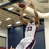 Forward L.G. Gill and his Duquesne teammates are headed overseas with an eye on defense.