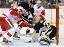 Detroit Red Wings center Stephen Weiss slides the puck past Penguins goalie Marc-Andre Fleury in the second period at the Consol Energy Center.
