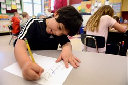 Joel Sanchez, 7, practices cursive writing in Lori Ryan's second-grade class at Howe Elementary School in Mt. Lebanon.