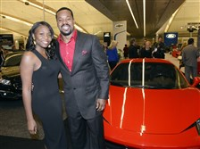 Christy and Joey Porter arrive in a Ferrari.