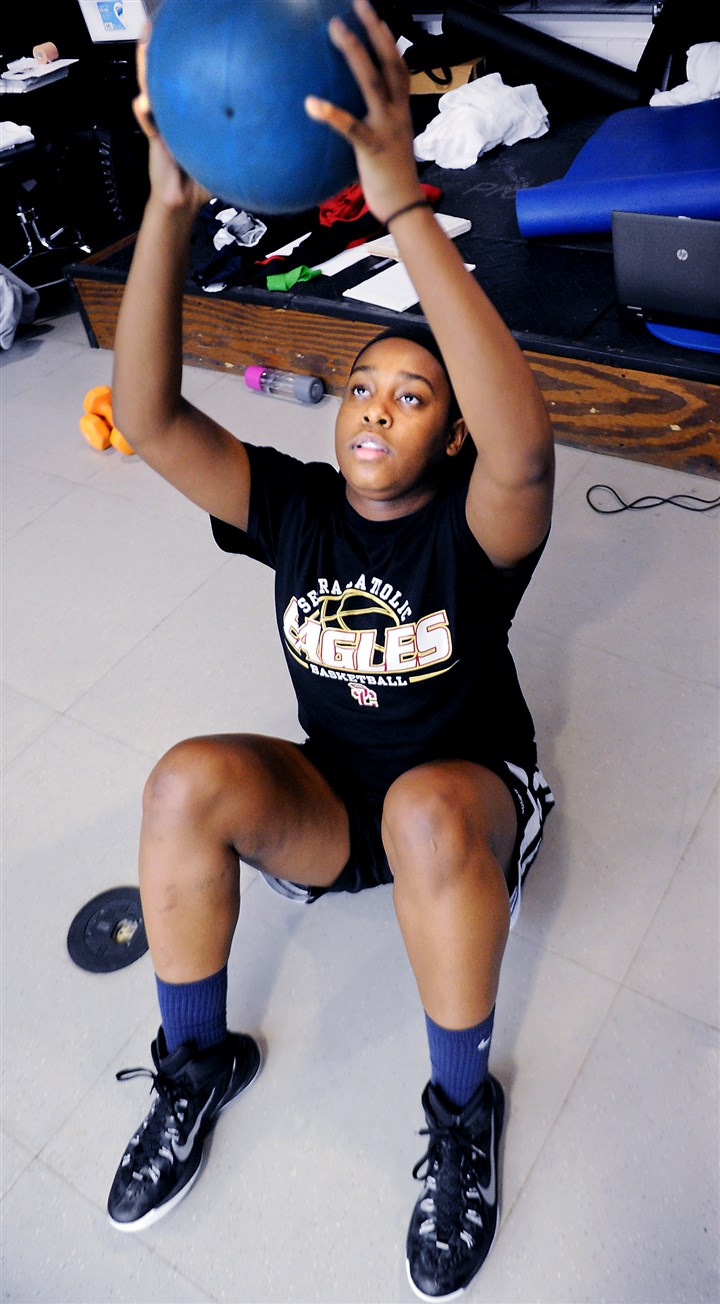 20150215JHHealthUPMC02-1 Aaliyah Coleman does a set of sit-up presses -- a prescribed exercise.