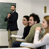 "Sean McGreevey, left, assistant dean for career development at Chatham University, teaches a class called ""Financial Wellness."" The class included, from left, senior Eir Rovira, graduate student Nick Bender and senior Nicole Werwie."