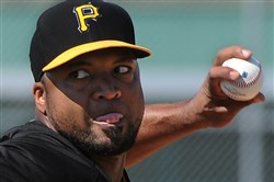 The Pirates' Francisco Liriano pitches live batting practice during workouts at Pirate City in Bradenton, Fla.