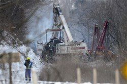 Crews work to clear tanker cars from the tracks Feb. 18 in Mount Carbon, W.Va.