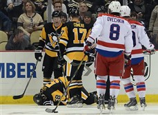 Penguins' Kris Letang remains down on the ice after taking a slash from Capitals' Alex Ovechkin in the third period Tuesday at Consol Energy Center.