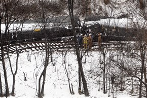 Crews work to clean up the derailed CSX train Feb. 18 in Mount Carbon.