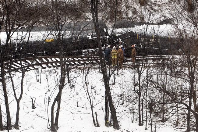 Crews work to clean up the derailed CSX train Feb. 18 in Mount Carbon.