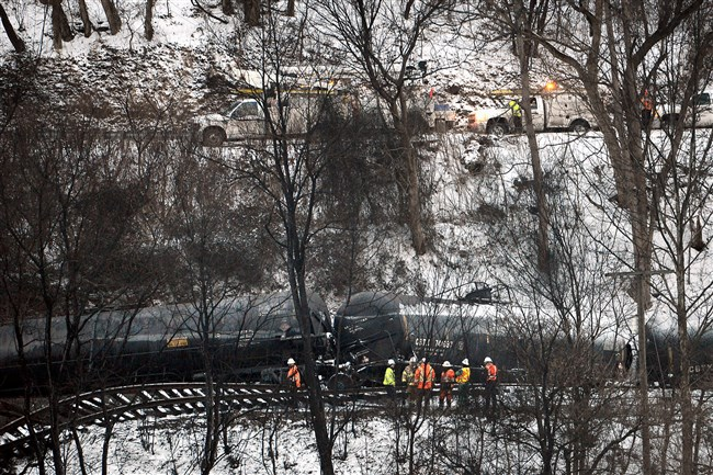 The CSX Corp train that derailed, ignited and spilled into the Kanawha River in Mount Carbon, W. Va., can be seen from across the river.