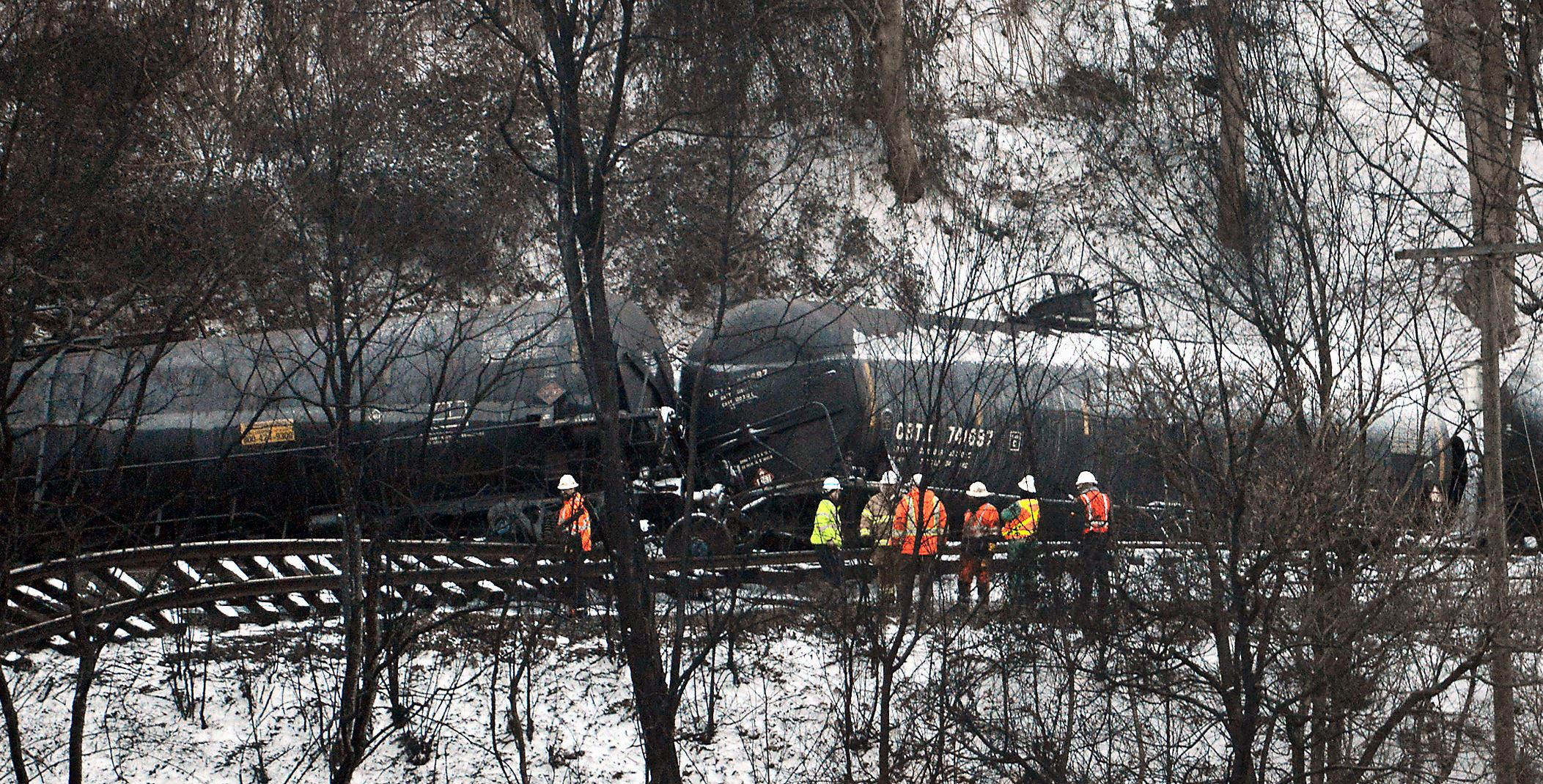 20150217MWHtrainLocal07-3 Investigators look over the scene Tuesday where a CSX train derailed and ignited near the Kanawha River in Mount Carbon, W.Va. Monday.