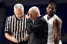 Penn State head coach Patrick Chambers, center, reacts to a call during an NCAA college basketball game against Wisconsin, Wednesday, Feb. 18, 2015, in State College, Pa. At right is Penn State's D. J. Newbill.