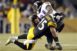 Safety Ryan Clark takes down Ravens receiver Anquan Boldin during an AFC divisional-round playoff game at Heinz Field.