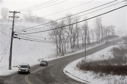 A snowy scene on a road in Murrysville, a short distance off Route 22. A new report said the fatality rate on rural roads in the state was 2.23 per 100 million miles, compared with 0.88 on other roads.