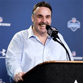 San Francisco 49ers coach Jim Tomsula answers a question during a news conference at the NFL football scouting combine in Indianapolis on Thursday.