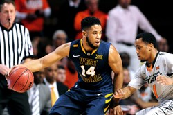 West Virginia guard Gary Browne had a career-best offensive game while also playing stellar defense Saturday against Oklahoma State.