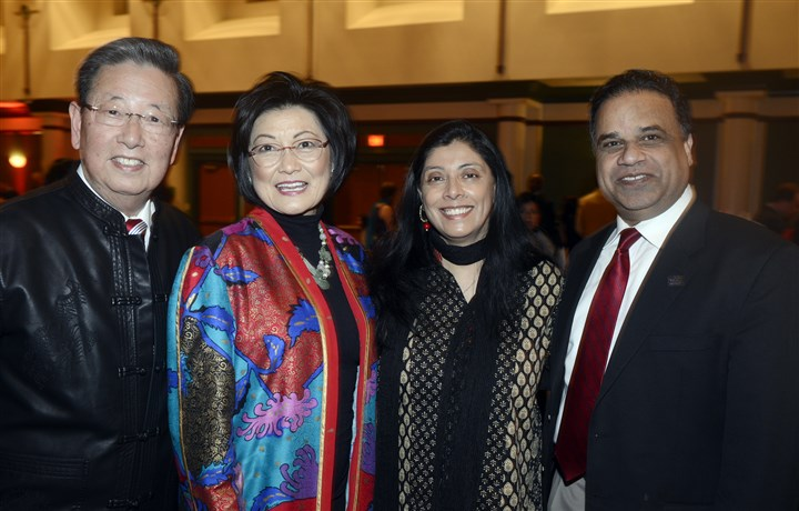 20150221bwChineseSEEN11-9 Savio and Pattie Woo with Surya and Sanjeev Shroff.