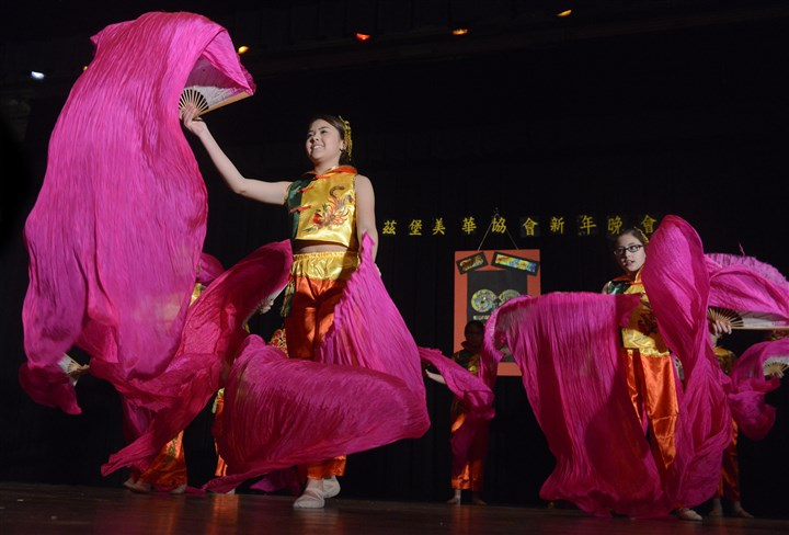 20150221bwChineseLocal02-1 From left, Allison Ai and Kiara Lin of the Organization of Chinese Americans, Pittsburgh Chapter pre-teen level dancers, perform for the groups' Lunar New Year Celebration.