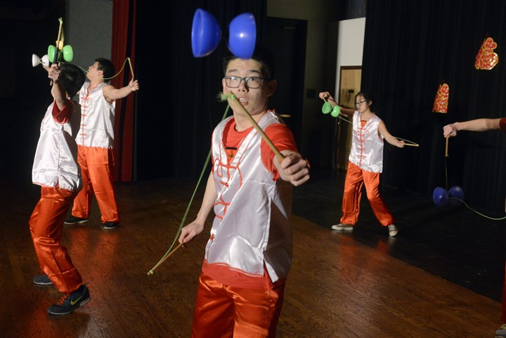 20150221bwChineseSEEN05-3 David Tsui, center, of the Tzu-Chi Academy Pittsburgh, works a Chinese Yo Yo at the Organization of Chinese Americans, Pittsburgh Chapter, Lunar New Year Celebration.