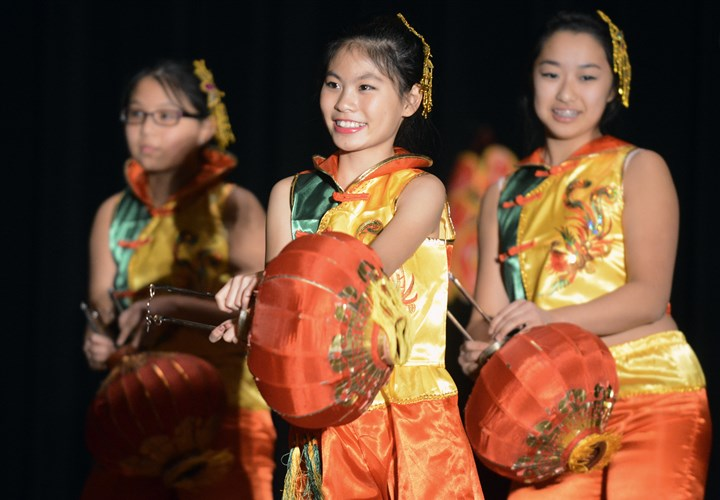 20150221bwChineseSEEN06-4 From left, Teresa Spence, Brianna Lin and Claire Cha of the Organization of Chinese Americans, Pittsburgh Chapter pre-teen level dancers, perform for the groups' Lunar New Year Celebration.