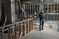 Kevin Sousa stands inside the construction zone that is Superior Motors, a new restaurant he's opening in Braddock.