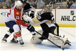 Penguins goaltender Marc-Andre Fleury stops a shot by Panthers winger Jimmy Hayes in the second period..