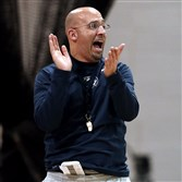 Penn State coach James Franklin claps enthusiastically during practice at Fordham University's Field House in New York in preparation for the Nittany Lions Pinstripe Bowl game against Boston College.