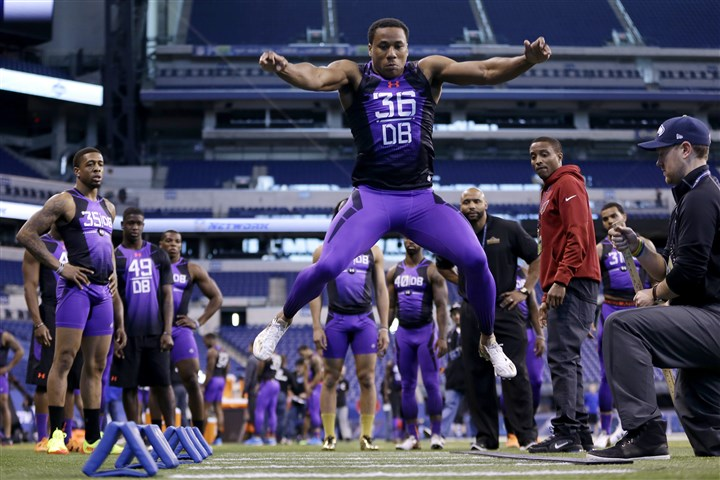 NFL Combine Football Washington defensive back Marcus Peters runs a drill at the NFL football scouting combine in Indianapolis, Monday, Feb. 23, 2015.