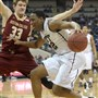 Pitt's Chris Jones works around Boston College's Patrick Heckmann in the second half Tuesday at the Petersen Events Center