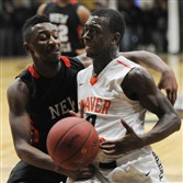 Beaver Falls' Javon Turner tries to drive around New Castle's Marquel Hooker.