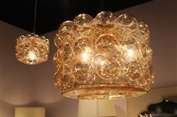 Jamie Young's Cici pendant lamp in gold carnival glass. It comes in clear and other colors and is available in two sizes.