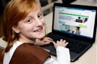 Violet Rignani, a Brownie from Mt. Lebanon, utilizes the internet to sell cookies for Girl Scouts.
