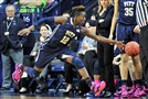 Pitt's Yacine Diop reaches for a loose ball Thursday night against No. 4 Notre Dame.