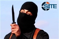 A masked, black-clad militant, who has been identified by the Washington Post newspaper as a Briton named brandishes a knife in this still image from a 2014 video obtained from SITE Intel Group February 26, 2015.