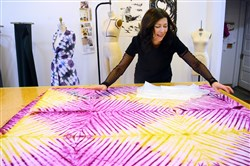 Fashion designer Diana Misetic works on fabrics from Africa to make a dress at her Shadyside studio for the first FashionAFRICANA clothing line.