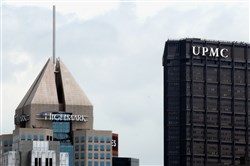 The Fifth Ave Place headquarters of Highmark and the U.S. Steel Tower offices of UPMC are seen in Downtown Pittsburgh.