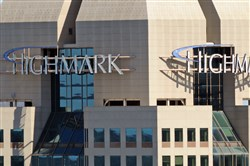 Highmark's sign atop their building, Downtown, in 2009. Highmark and other health insurance carriers are eyeing offering individual and small group alternative policies to the Affordable Care Act that come with lower premiums and fewer benefits.