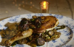 The Brick Chicken is served with roasted garlic potatoes, burnt leek puree and Brussels sprouts.