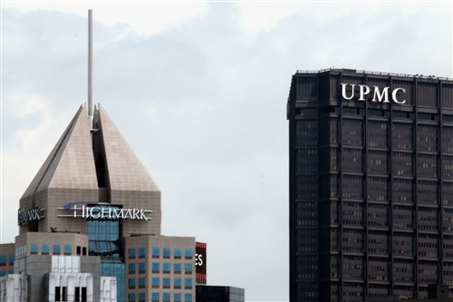 The Fifth Ave Place headquarters of Highmark in view with the U.S.Steel Tower offices of UPMC, in downtown Pittsburgh .