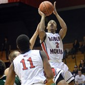 Robert Morris' Marcquise Reed gets a shot up against Wagner in the first half Feb. 26 at the Sewall Center.