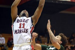 Robert Morris' Rodney Pryor goes in for a layup against Wagner's Marcus Burton in the second half.