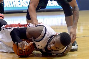 Robert Morris' Lucky Jones grabs a loose ball against Wagner's Marcus Burton in the second half.