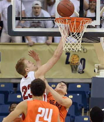 Indiana's Riley Stapleton makes the game-winning basket over Beaver Falls' Zach Duffy in the WPIAL Class AAA championship Friday at Petersen Events Center.