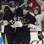 Penguins Evgeni Malkin is congratulated by Kris Letang after scoring against the Blue Jackets in the first period Sunday at Consol Energy Center.
