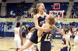Norwin's Taylor Ingel jumps into the arms of Danielle McMaster after defeating Penn Hills in the WPIAL Class AAAA championship Saturday at Petersen Events Center.