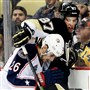 The Blue Jackets' Corey Tropp battles with Sidney Crosby along the boards in the second period Sunday at Consol Energy Center.