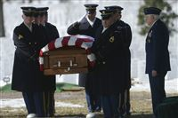 Retired Air Force General William J. Mall, Jr., right, stands at attention as Tech Sgt. Charles Johnston of the North Side is laid to rest with full military honors at Arlington National Cemetery on Monday, March 2, 2015. Mr. Mall was 11 years old when his cousin Charles Johnston went missing near Papua New Guinea in 1944.