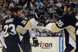 The Penguins' Steve Downie, left, hasn't exactly been a model of disciplined play this season.