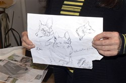 Sculptor Susan Wagner displays one of the sketches she used to create a statue of Pittsburgh police K-9 Rocco, which be displayed at the police memorial on the North Shore.