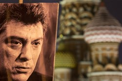 A portrait of Boris Nemtsov, the Russian opposition leader gunned down Friday near the Kremlin, sits atop a mound of flowers and remembrances left by supporters at the spot where he died.