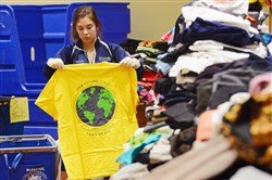 Rachel Lauver, 19, of PittServes and a freshman at the University of Pittsburgh, sorts clothes at the William Pitt Union in Oakland on Tuesday.